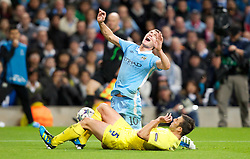 18.10.2011, City of Manchester Stadion, Manchester, ENG, UEFA CL, Gruppe A, Manchester City (ENG) vs FC Villarreal (ESP), im Bild Manchester City's Edin Dzeko in action against Villarreal CF's Carlos Marchena // during UEFA Champions League group A match between Manchester City (ENG) and FC Villarreal (ESP) at City of Manchester Stadium, Manchaster, United Kingdom on 18/10/2011. EXPA Pictures © 2011, PhotoCredit: EXPA/ Propaganda Photo/ Vegard Grott +++++ ATTENTION - OUT OF ENGLAND/GBR+++++