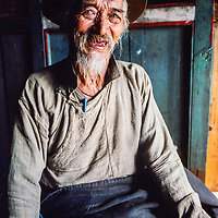 Kunchok Chombi Sherpa - a veteran of the first successful Everest expedition in 1952 - relaxes in a house in Namche Bazar in the Khumbu region of Nepal 1986.
