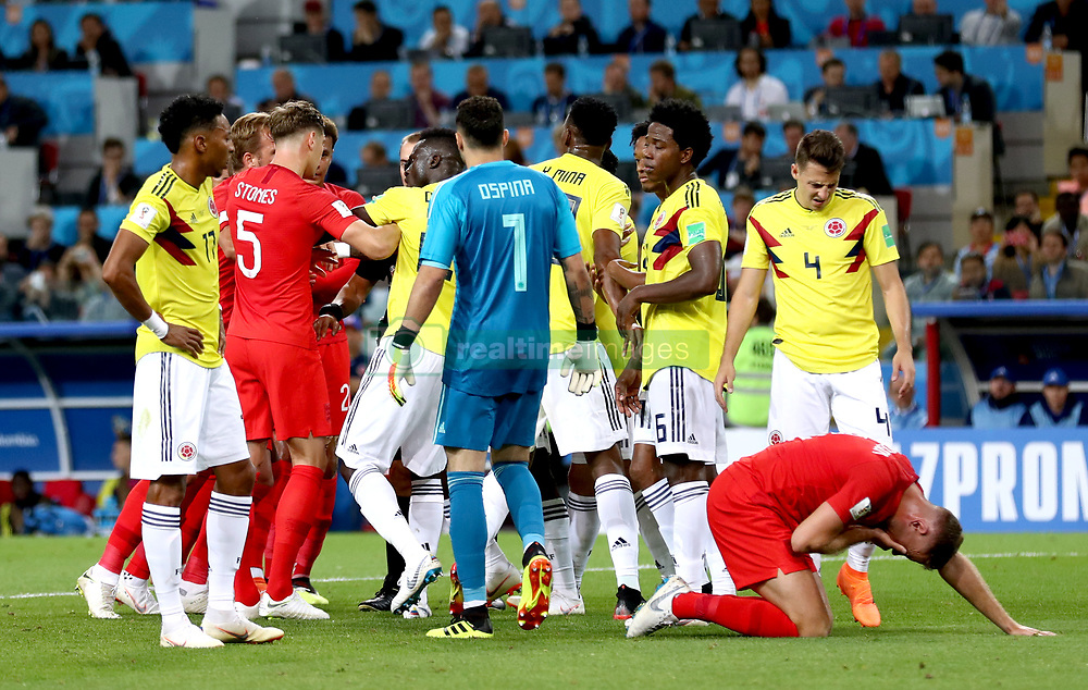 Tempers flare whilst England's Jordan Henderson (right) crouches on the floor after being head butted by Colombia's Wilmar Barrios during the FIFA World Cup 2018, round of 16 match at the Spartak Stadium, Moscow.