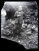 broken glass plate with adult man standing casual outdoors