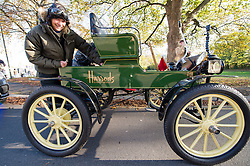 EDITORIAL USE ONLY Jodie Kidd makes a scheduled battery change to her Harrods 1901 veteran Pope Waverley electric car at Redhill in Surrey during the Bonhams London to Brighton Veteran Car Run.