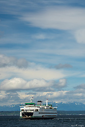 United States, Washington, Seattle, ferry in Puget Sound with Olympic Mountains in distance