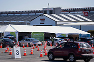 Cars line up as Lehigh Valley Health Network holds a COVID-19 mass vaccination clinic Mar. 20, 2021, at Pocono Raceway in Long Pond, Pennsylvania. Administrators were expected to vaccinate 3,000 people in the state of Pennsylvania's Phase 1A with the Moderna vaccine.