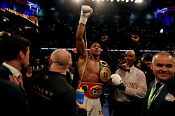 Anthony Joshua celebrates victory over Wladimir Klitschko during the IBF, WBA and IBO Heavyweight World Title bout against Anthony Joshua at Wembley Stadium, London.