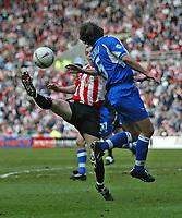 Photo. Andrew Unwin.<br /> Sunderland v Derby County, Nationwide League Division One, Stadium of Light, Sunderland 27/03/2004.<br /> Derby's Jeff Kenna (r) challenges against Sunderland's John Oster (l).