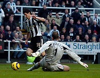 Photo: Jed Wee.<br />Newcastle United v Middlesbrough. The Barclays Premiership. 02/01/2006.<br />Newcastle's Albert Luque (L) squanders an early chance as he beats the offside trap and rounds Middlesbrough goalkeeper Mark Schwarzer only to see his shot hit the post.
