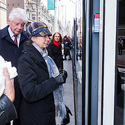 NLD/Amsterdam/20130413- Oud premier Wim Kok wacht op de tram samen met zijn partner Rita Roukema