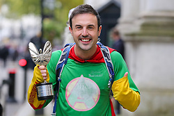 © Licensed to London News Pictures. 29/10/2019. London, UK. Gloucester's adventure-man JAMINE McDONALD, the Pride of Britain fundraiser of the Year 2019 arrives in Downing Street with his trophy to attend a reception with Prime Minister BORIS JOHNSON. JAMINE McDONALD raised more than £1million for charity through running and cycling. Photo credit: Dinendra Haria/LNP