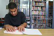 Library for the Blind Blind Man reads a Braille Book