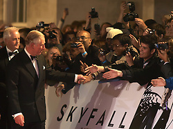 The Prince of Wales (L), is greeted by the crowds as he arrives for the World Premiere of the latest James Bond film  'Skyfall', Royal Albert Hall, London, October 23, 2012. Photo by Max Nash / i-Images.
