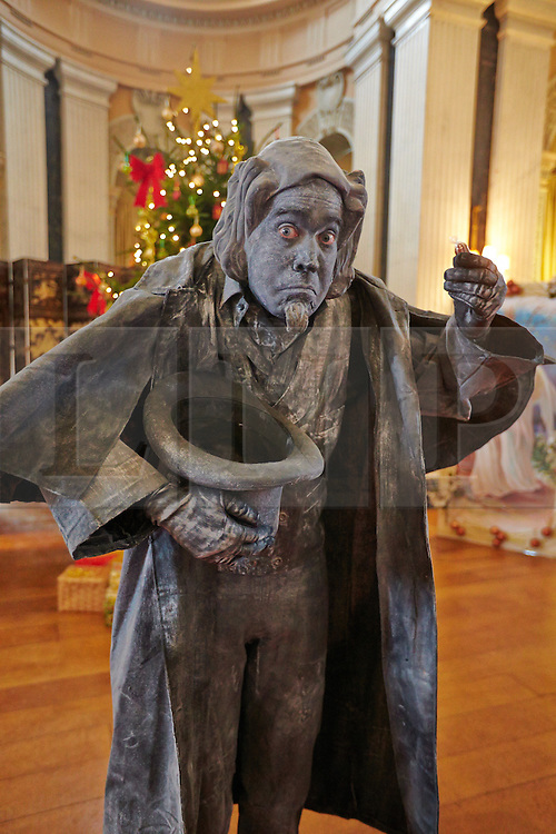 © Licensed to London News Pictures.  09/11/2013. WOODSTOCK, UK. Living statue Scrooge inspired by the classic story A Christmas Carol at Blenheim Palace during their Dickensian Christmas. The themed event opened to the public today (Sat 9th Nov) and runs until the 13th December.  Photo credit: Cliff Hide/LNP