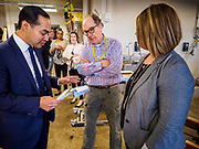 15 APRIL 2019 - DES MOINES, IOWA: JULIÁN CASTRO talks to BEN MALLOY, a carpentry teacher, during Castro's visit to the Central Campus Skilled Trades Alliance at the Des Moines Public School's Central Campus Monday. Castro is on his third visit to Iowa since declaring his candidacy for the Democratic ticket of the US Presidency. Casto talked to students and administrators about skilled trades education and toured the campus. Iowa traditionally hosts the the first selection event of the presidential election cycle. The Iowa Caucuses will be on Feb. 3, 2020.                PHOTO BY JACK KURTZ