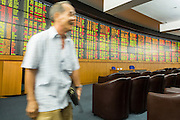 02 SEPTEMBER 2013 - BANGKOK, THAILAND:  A man walks away from the stock ticker at Asia Plus Securities headquarters in central Bangkok. The Thai stock market has declined more than 20% from its 2013 high as data as Thailand entered a recession in the second quarter. The loss of value in the Stock Exchange of Thailand (SET) is the greatest sell off since the end of the Asian financial crisis in 1998. Foreign investors have sold more than $1 billion of local shares this month amid signs of slowing regional economic growth and speculation that the U.S. Federal Reserve will soon cut its stimulus.     PHOTO BY JACK KURTZ