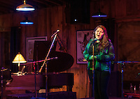 Kate Persson sings Firefall on stage during Laconia High School's Open Mic Coffee House at Pitman's Freight Room Tuesday evening.  (Karen Bobotas/for the Laconia Daily Sun)