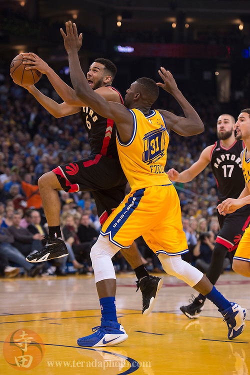 November 17, 2015; Oakland, CA, USA; Toronto Raptors guard Cory Joseph (6) shoots the basketball against Golden State Warriors center Festus Ezeli (31) during the second quarter at Oracle Arena.