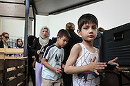 Women and children follows a separated line. Crowd and tension caused by the fear of not find some food left can get the situation tense and violent
