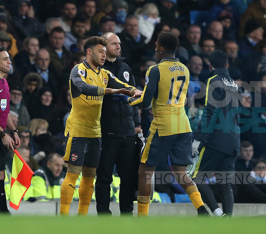 Alex Oxlade-Chamberlain of Arsenal replaces Alex Iwobi of Arsenal during the English Premier League match at the Etihad Stadium, Manchester. Picture date: December 18th, 2016. Picture credit should read: Simon Bellis/Sportimage