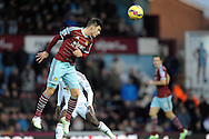 Aaron Cresswell of West Ham United in action. Barclays Premier league match, West Ham Utd v Swansea city at the Boleyn ground, Upton Park in London on Sunday 7th December 2014.<br /> pic by John Patrick Fletcher, Andrew Orchard sports photography.