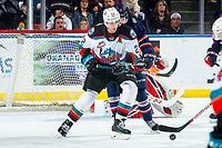 KELOWNA, BC - MARCH 7: Dillon Hamaliuk #22 of the Kelowna Rockets checks Calen Addison #2 of the Lethbridge Hurricanes at Prospera Place on March 7, 2020 in Kelowna, Canada. Addison was selected in the 2018 NHL entry draft by the Pittsburgh Penguins. Hamaliuk wws selected in the 2019 NHL entry draft by the San Jose Sharks. (Photo by Marissa Baecker/Shoot the Breeze)