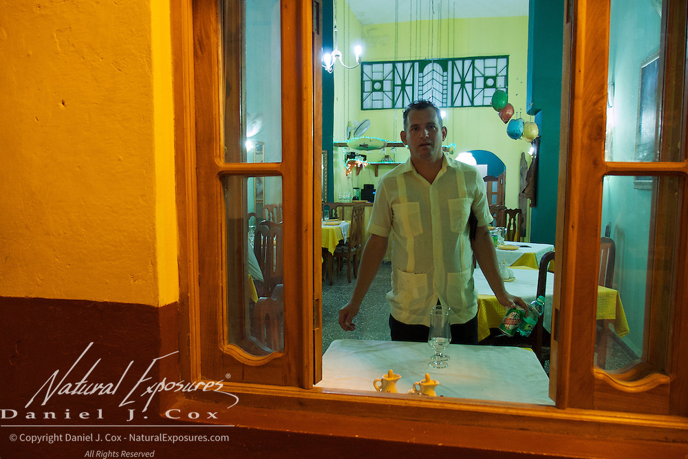 A local restaurant owner cleaning up. Havana, Cuba.