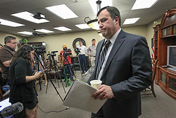 April 12, 2018 - Wichita, KS, USA - Sedgwick County district attorney Marc Bennett leaves a press conference Thursday after announcing that the Wichita police officer involved in the fatal shooting of Andrew Finch during a swatting incident in late December will not be charged. (Credit Image: © Fernando Salazar/TNS via ZUMA Wire)
