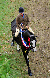 © Licensed to London News Pictures. 12/05/2017. Windsor, UK.  A horse being ridden back from competition on day three of the Royal Windsor Horse show. The five day equestrian event takes place in the grounds of Windsor Castle. Photo credit: Ben Cawthra/LNP