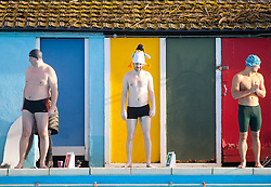 © Licensed to London News Pictures. 24/01/2015. London, UK. Contestants brave cold temperatures at the 6th UK Cold Water Swimming Championships at Tooting Bec Lido, south London. Over, 650 swimmers will take the plunge to compete in a variety of chilly races.  Photo credit : Isabel Infantes / LNP