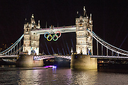 © Licensed to London News Pictures. 25/07/2012. London, UK. A colourful illuminated boat passes under Tower Bridge in London in a rehearsal event believed to be related to the opening ceremony of the 2012 Olympic Games. Photo credit : Vickie Flores/LNP