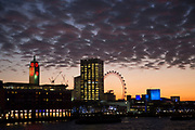 Incredible cloud formations at sunset over the River Thames looking South towards the Oxo Tower, Sea Containers House and the South Bank in London, England, United Kingdom.
