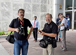 10 June  2015. New Orleans, Louisiana. <br /> Photographers David Rae Morris (l) and Ted Jackson outside Civil Distrcit Court for the Billion Dollar family feud.<br /> Benson is the billionaire owner of the NFL New Orleans Saints, the NBA New Orleans Pelicans, various auto dealerships, banks, property assets and a slew of business interests. Rita, her brother and mother demanded a competency hearing after Benson changed his succession plans and decided to leave the bulk of his estate to third wife Gayle, sparking a controversial fight over control of the Benson business empire.<br /> Photo©; Charlie Varley/varleypix.com