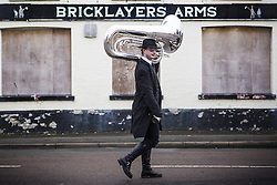 January 14, 2017 - Whittlesey, Cambridgshire, UK - Whittlesey UK. Picture shows a musician arriving in the town of Whittlesey at the 38th Straw Bear festival. In Whittlesey it was the custom on the Tuesday following Plough Monday to dress one of the confraternity of the plough in straw and call him a Straw Bear. The bear was then taken around town to entertain the folk who on the previous day had subscribed to the rustics, a spread of beer, tobacco & beef. The bear was made to dance in front of houses & gifts of money, beer & food was expected. (Credit Image: © Andrew Mccaren/London News Pictures via ZUMA Wire)