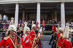 Windsor, UK. 18 May, 2019. Princess Anne, Princess Royal, watches from the Guildhall as the Band of the Household Cavalry leads the Household Cavalry on their Freedom of Entry March through Windsor by way of a farewell to the town where they have been based for over 200 years in advance of their relocation to Salisbury Plain later this year. The march comprised up to 250 marching troops, 8 mounted troops, the Band of the Household Cavalry and veterans.
