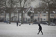 A figure walks uphill in Ruskin Park, south London during the bad weather covering every part of the UK and known as the 'Beast from the East' because Siberian winds and very low temperatures have blown across western Europe from Russia, on 1st March 2018, in Lambeth, London, England.