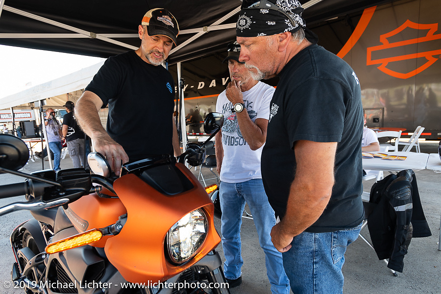 HD head of PR Paul James helps familiarize Kevin Decker (seated) and his friend Steve Wells with the Harley-Davidson Live Wire electric bike in the Jumpstart display of the Harley-Davidson Garage at the Full Throttle Saloon during the  during the Sturgis Black Hills Motorcycle Rally. Sturgis, SD, USA. Tuesday, August 6, 2019. Photography ©2019 Michael Lichter.