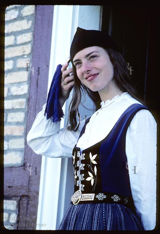 Mist Thorkelsdottir, guide at Arbaer Folk Museum dressed in nat'l costume, waits to greet visitors Iceland
