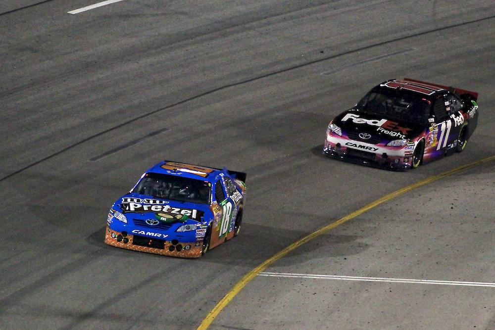 Apr 30, 2011; Richmond, VA, USA; NASCAR Sprint Cup Series drivers Kyle Busch (18) and Denny Hamlin (11) during the Matthew and Daniel Hansen 400 at Richmond International Raceway. Mandatory Credit: Peter Casey-US PRESSWIRE
