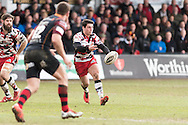 Sam Hidalgo-Clyne of Edinburgh rugby passes the ball out as Adam Warren of the Newport Gwent Dragons closes him down. Guinness Pro12 rugby match, Newport Gwent Dragons v Edinburgh Rugby at Rodney Parade in Newport, South Wales on Sunday 27th March 2016.<br /> pic by  Simon Latham, Andrew Orchard sports photography.