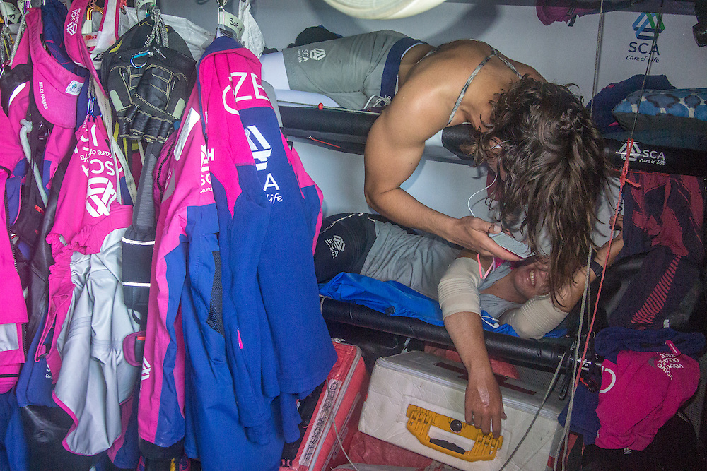 October, 2014. Leg 1 onboard Team SCA. Sara Hastreiter shares a joke with Stacey Jackson after watch.