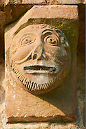 Norman Romanesque exterior corbel no 40 - sculpture of a mans head.  The Norman Romanesque Church of St Mary and St David, Kilpeck Herefordshire, England. Built around 1140 .<br /> <br /> Visit our MEDIEVAL PHOTO COLLECTIONS for more   photos  to download or buy as prints https://funkystock.photoshelter.com/gallery-collection/Medieval-Middle-Ages-Historic-Places-Arcaeological-Sites-Pictures-Images-of/C0000B5ZA54_WD0s