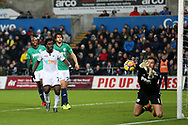 Wilfried Bony of Swansea city watches as Ben Foster, the West Bromwich Albion goalkeeper makes a save.Premier league match, Swansea city v West Bromwich Albion at the Liberty Stadium in Swansea, South Wales on Saturday 9th December 2017.<br /> pic by  Andrew Orchard, Andrew Orchard sports photography.