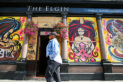 © Licensed to London News Pictures. 24/08/2019. London, UK. A woman walks past The Elgin which is boarded up ahead of the 2019 Notting Hill Carnival which takes place this weekend and on bank holiday Monday. Up to 1 million people are expected to attend the biggest street party in Europe. Photo credit: Dinendra Haria/LNP
