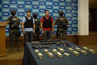 MEXICO CITY, June 21, 2012  Jesus Alfredo Guzman Salazar (R-FRONT), alleged son of Sinaloa's cartel leader Joaquin Guzman Loera ''El Chapo'' and Kevin Daniel Beltran Rios (L-FRONT), are presented at the Mexico's Navy Marine Secretary to  media representatives, in Mexico City, capital of Mexico, on June 21, 2012. (Credit Image: © Rodrigo Oropeza/Xinhua/ZUMAPRESS.com)