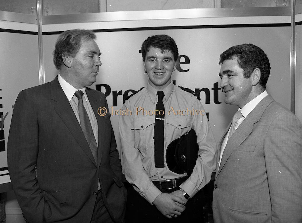 28/10/1985<br /> 10/28/1985<br /> 28 October 1985<br /> Launch of Gaisce The Presidents Award at Aras an Uachtarain. President Dr. Patrick Hillery launched the new national youth award scheme to be the nations highest award to Irish young people aged 15-25. Picture shows Dr. A.F.J. O'Reilly (left) Chairman of the Management Committee of the Award Scheme with Garda Donal Smyth (Castleblaney, Co. Monaghan) and Mr. John Murphy, (right) Executive Director of the Award.