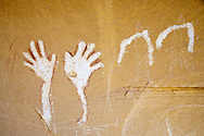 waving hands Fremont People rock art pictograph (prehistoric rock painting dated 600-1300 AD) covering a petroglyph (prehistoric rock carving)in the Douglas Creek Canyon south of Rangely, Colorado, USA on Bureau of Land Management (BLM) public lands.