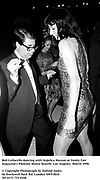 Bob Collacello dancing with Anjelica Huston at Vanity Fair magazine's Phoenix House benefit. Los Angeles. March 1990.<br /><br />© Copyright Photograph by Dafydd Jones<br />66 Stockwell Park Rd. London SW9 0DA<br />Tel 0171 733 0108<br />Film.90194/26