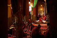 Monks chant at a monastery just northeast of Ganze, Tibet (China).