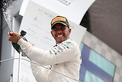 Mercedes' Lewis Hamilton celebrates his victory during the 2017 British Grand Prix at Silverstone Circuit, Towcester.