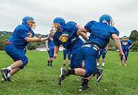 Gilford offensive lineman (#67) Drake Parker works on offensive drills with his team mates during Tuesday afternoon's practice at the Meadows Field.  (Karen Bobotas/for the Laconia Daily Sun)