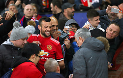 Manchester United manager Jose Mourinho signs autographs for fans prior to kick off