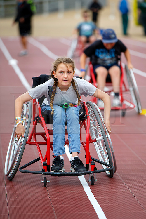 © Licensed to London News Pictures. 03/09/2016. LONDON, UK. Children have a paralymic torch relay race with wheelchairs to experience the disability sports at National Paralympic Day and Liberty Festival in Queen Elizabeth Olympic Park in London on Saturday 3 Spetember 2016. Photo credit : Tolga Akmen/LNP